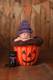 Sleeping Newborn Baby Girl Wearing a Witch Costume Royalty Free Stock Photo