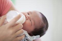 Free Sleeping Newborn Baby Little Girl Drinking A Milk From Bottle Royalty Free Stock Photos - 100310028