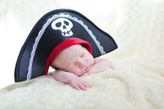 Sleeping newborn baby. In a pirate hat royalty free stock image