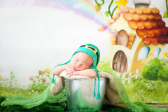 Sleeping newborn baby in a St. Patrick`s Day hat stock illustration