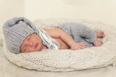 Sleeping newborn baby in a wrap Stock Image
