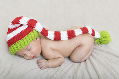 Sleeping newborn baby in a wrap Stock Image