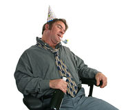 Sleeping It Off. A man passed out in a chair after the office party. (horizontal view Royalty Free Stock Images