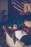 Sleeping off that hangover. Stock Photo