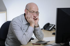 Sleeping in the office. A bald man sleeps at the office Stock Photos