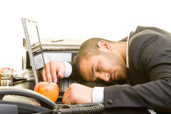 Sleeping in the office. Business man sleeping on his laptop at his desk Royalty Free Stock Photo