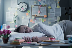 Sleeping in office Stock Images