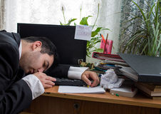 Sleeping office worker with deadline today text Stock Photography