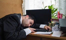 Sleeping office worker Royalty Free Stock Photos