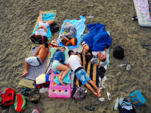 Sleeping On The Beach. Stock Photo