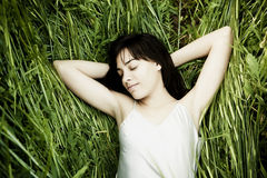 Sleeping over the grass. Young beautiful woman sleeping over the grass Stock Images