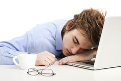 Sleeping over the laptop Royalty Free Stock Photography