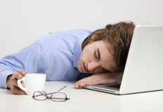Sleeping over the laptop Royalty Free Stock Photo