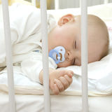 Sleeping with pacifier royalty free stock image