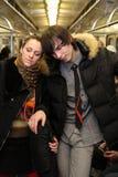 Sleeping pair in subway wagon Royalty Free Stock Photo