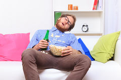 Sleeping at a party with popcorn and beer Royalty Free Stock Photography