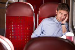 Sleeping passenger using public transport Stock Photo