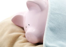 Sleeping piggy bank Royalty Free Stock Image