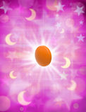 Sleeping Pill. An orange pill on a pink moons and stars background Royalty Free Stock Photography