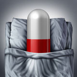 Sleeping Pill. Concept and prescription drugs as a treatment solution for insomnia to help you get sleep as a giant pill getting sleep inside a bed as a health Stock Photo