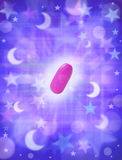 Sleeping Pill Tablet. A pink pill with a background of stars and moons Stock Photo