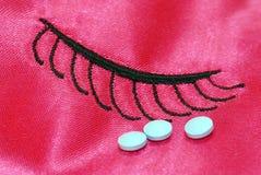 Sleeping pills. On top of sleeping mask stock image