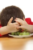 Sleeping in a plate. Boy sleeping in a plate while sitting at the table Royalty Free Stock Image