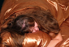 Sleeping plump women on silk royalty free stock photography