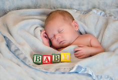 Sleeping portrait of a baby, with blocks Stock Photography