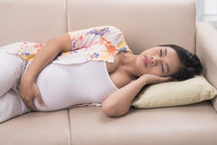 Sleeping pregnant woman Stock Image