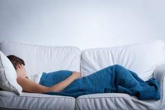 Sleeping pregnant woman Stock Photo
