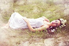 Sleeping pretty woman with flower in hair Stock Photo