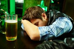 Sleeping in pub Stock Images