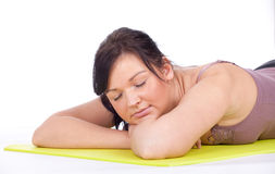 Sleeping, resting young fitness woman Royalty Free Stock Images