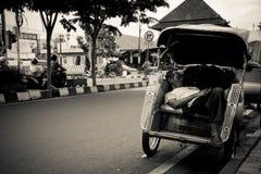 A sleeping rickshaw driver of Yogyakarta, Indonesia Stock Image