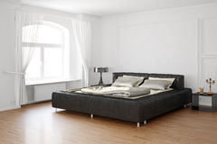 Sleeping room with bed and leather. Sleeping room with bed and hardwood floor Royalty Free Stock Images