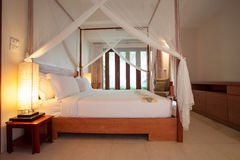 Sleeping room with four-poster bed royalty free stock image
