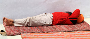 Sleeping sadhu. Sadhu sleeping in sunny day at shiva temple hoshiarpur punjab india stock photo