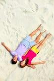 Sleeping on the sand Royalty Free Stock Photos