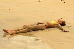 Sleeping on sand beach Royalty Free Stock Photography