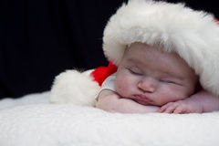 Sleeping Santa Baby Stock Image
