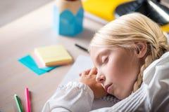 Sleeping school girl in classroom Stock Photography