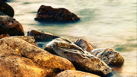 Sleeping sea with coastal rocks Stock Image