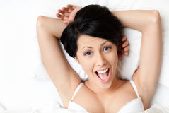 Sleeping sexy woman in the bed Royalty Free Stock Image