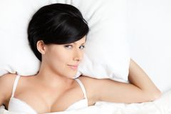 Sleeping sexy woman in the comfortable bed Stock Photography