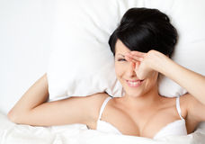 Sleeping woman in the soft bed Stock Photography