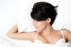 Sleeping woman in the wide bed Stock Images