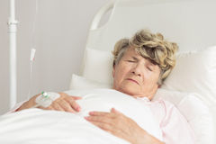 Sleeping sick woman Royalty Free Stock Photography