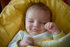 Sleeping smiling newborn baby Stock Image