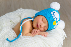 Sleeping smiling newborn baby Royalty Free Stock Photo